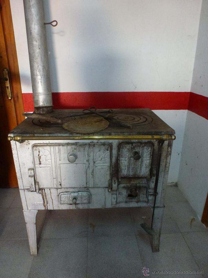 Estufa de llenya, cuina econòmica de ferro fos
